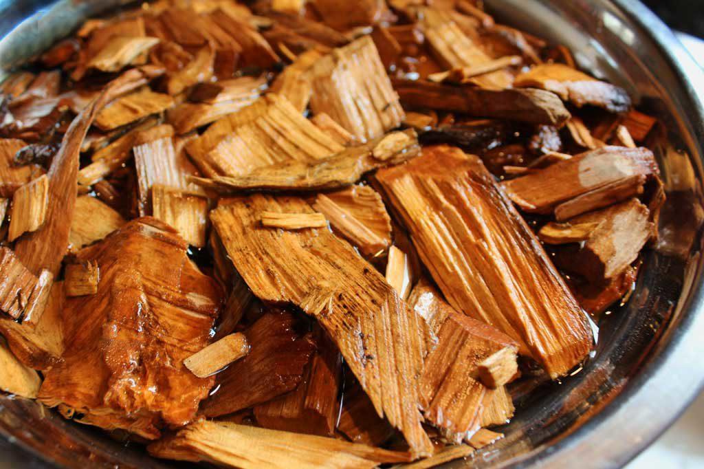 smoking wood soaking in water
