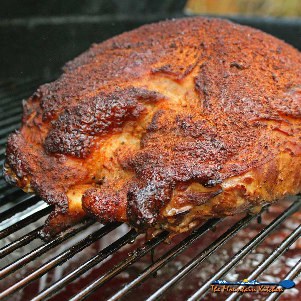 With very little effort required, this pecan applewood smoked turkey breast is rubbed with a simple poultry seasoning, smoked over a pan of cranberry infused water for a moist smoking environment, with smoky coals, pecan wood chunks, andwet applewood chips. Tender, juicy turkey like no other! | TheMountainKitchen.com