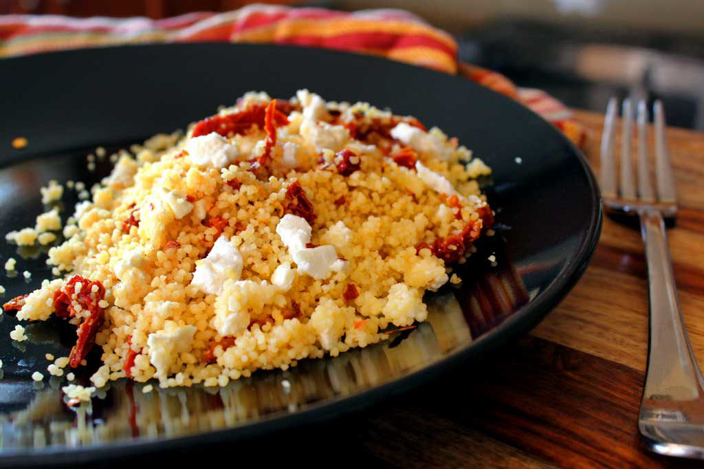 This Mediterranean Couscous gets wonderful flavor from chicken broth, sweet and tangy sun-dried tomatoes, feta cheese and a touch of heat red pepper flakes. | TheMountainKitchen.com