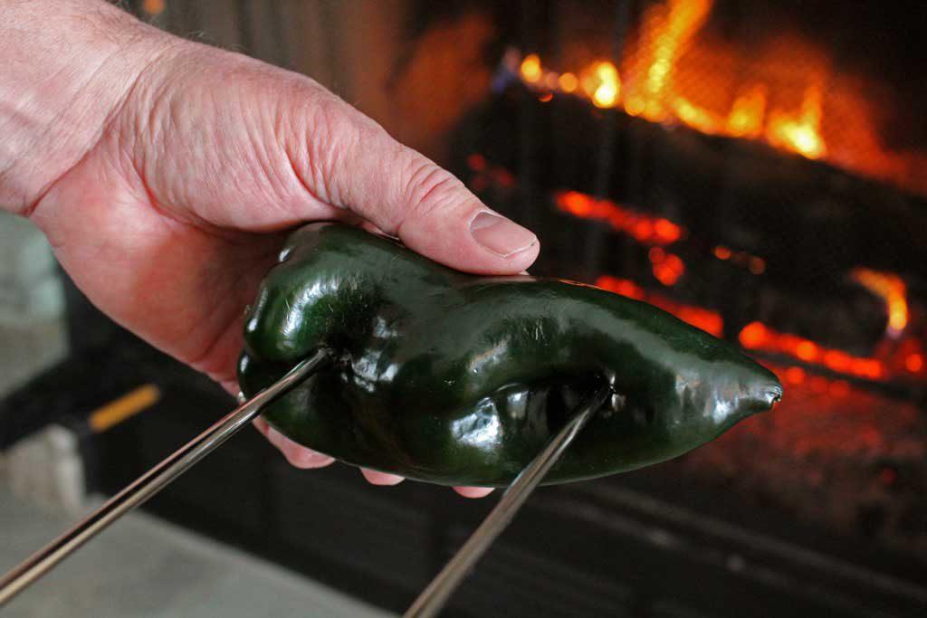 roasting poblano on open fire