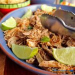 Pork Carnitas are cooked slowly in s rich flavorful broth before putting it into the oven to become crispy and caramelized. The deeply flavorful, melt-in-your-mouth oven-roasted pork carnitas are perfect for filling tacos, burritos or placing on top of nachos with a crunchy, refreshing orange cabbage slaw. | TheMountainKitchen.com
