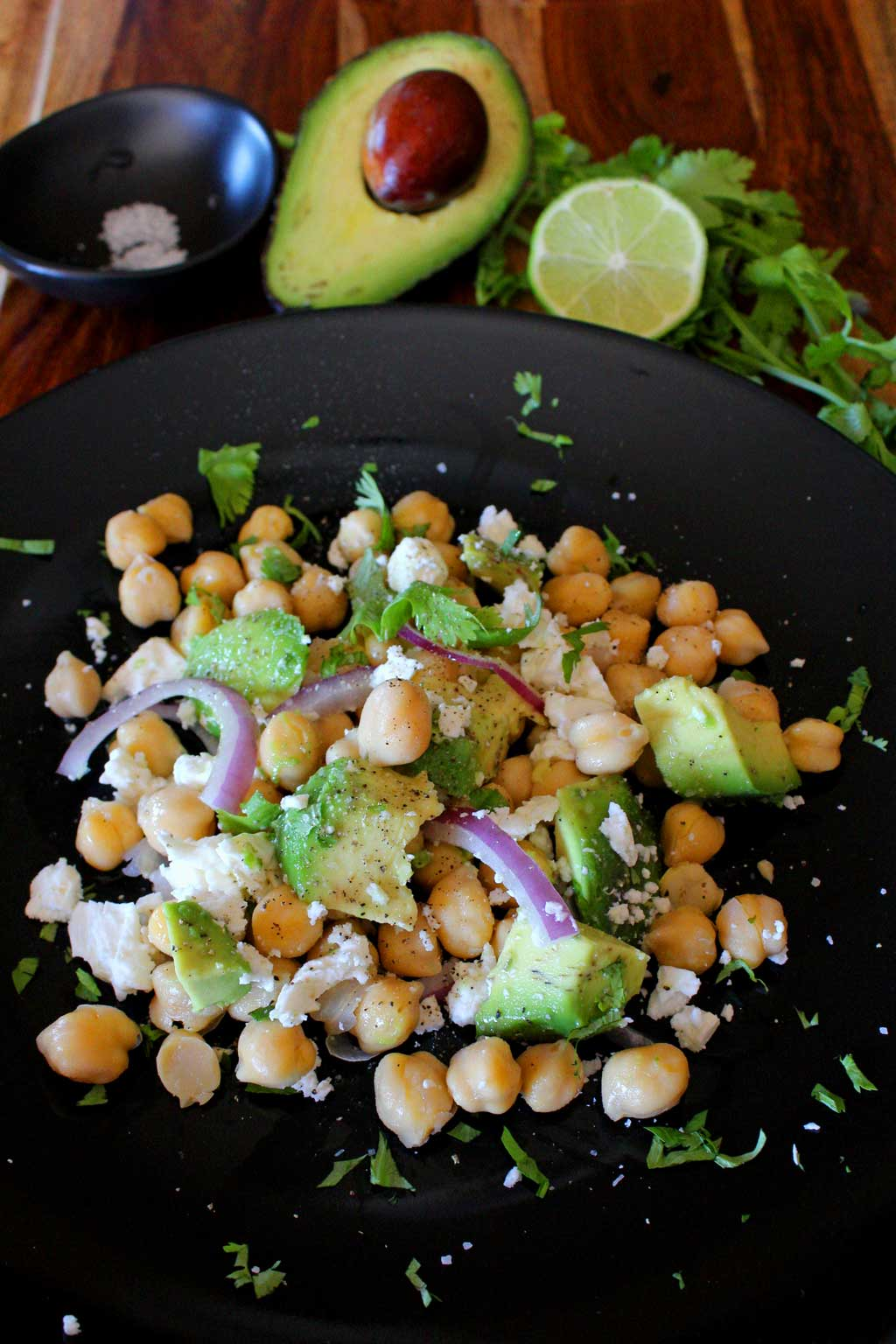 It only takes 5-minutes to make this delicious high protein, high fiber chickpea avocado salad. This is a vegetarian salad recipe that's full of fresh and healthy ingredients, perfect for a super healthy Meatless Monday lunch or a side dish to share at a weekend picnic or potluck! | TheMountainKitchen.com