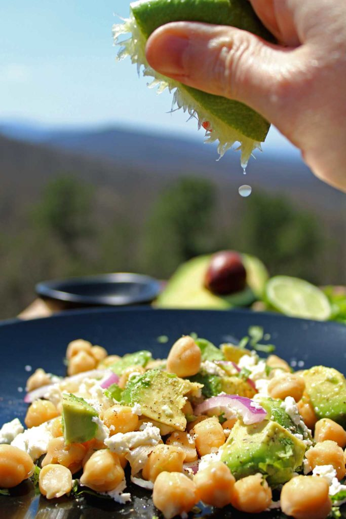 squeezing lime onto salad