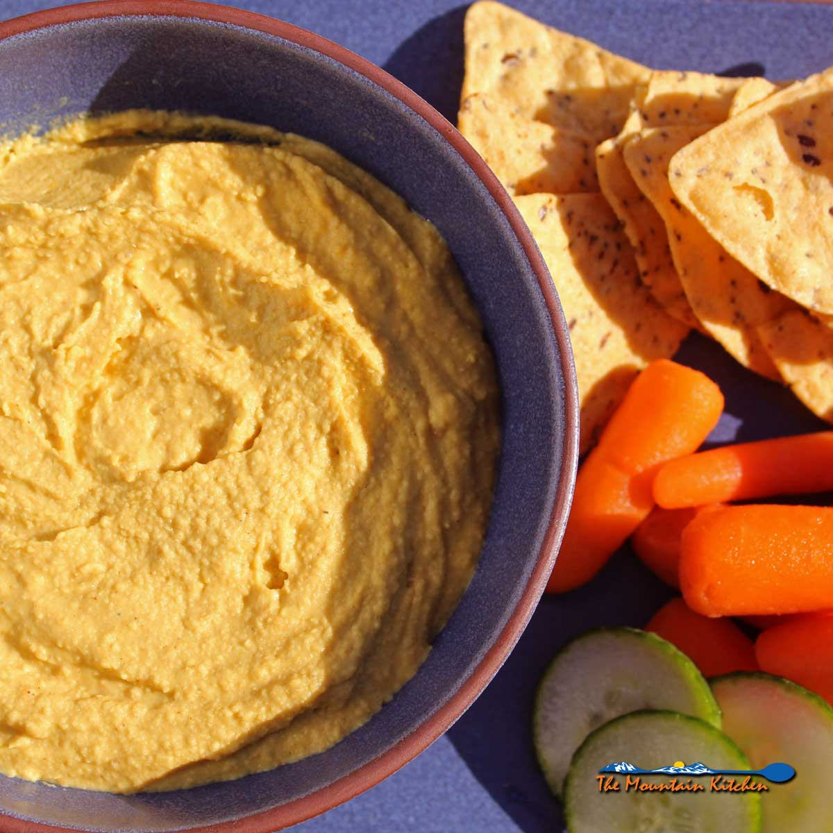 Curry hummus gets extra creaminess from greek yogurt and warm earthy spice from madras curry. A healthy snack packed with protein and fiber. It's addictive!