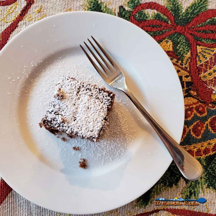 gingerbread cake on plate with fork and holiday placemat
