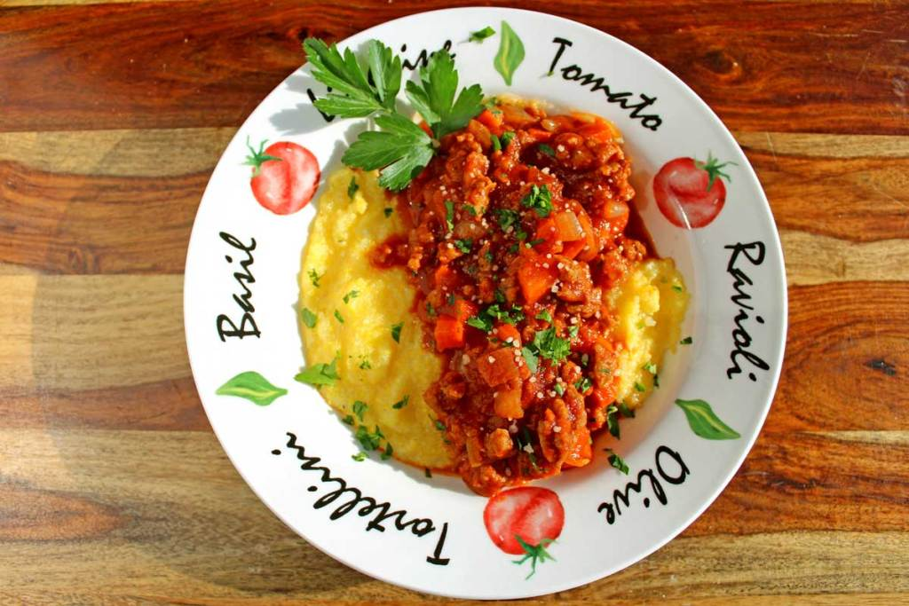 Hot Italian sausage is the star ingredient of this sausage ragu which lends rich layers of flavor simmered with mild tomatoes and seasoned vegetables.