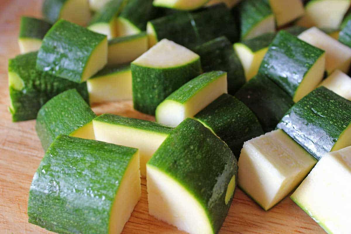 Diced zucchini on a cutting board.