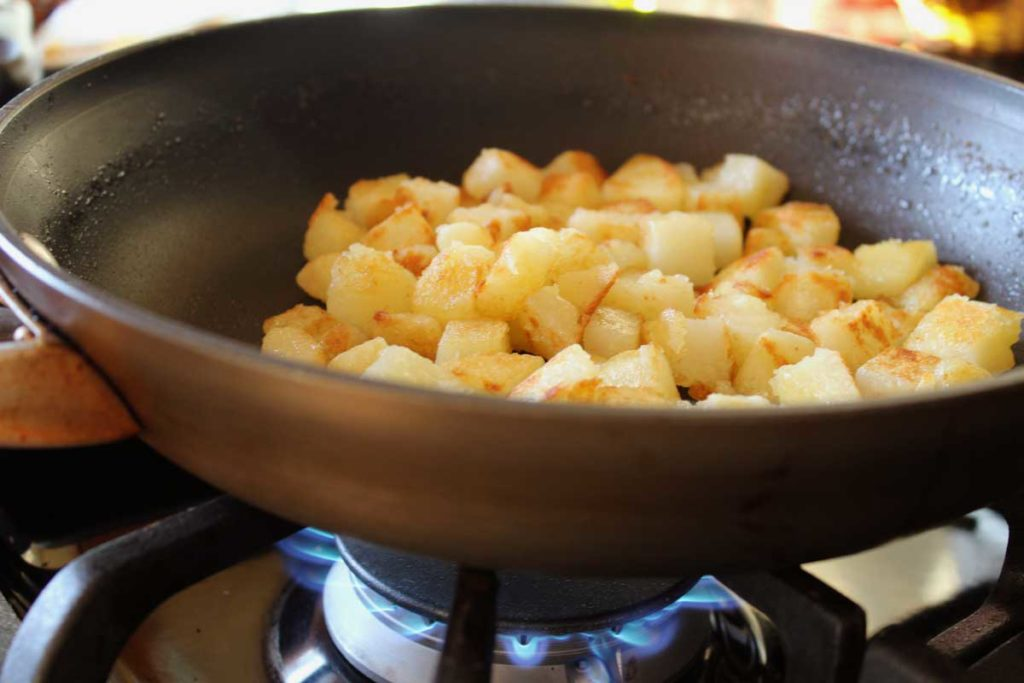 potatoes browning in a skillet