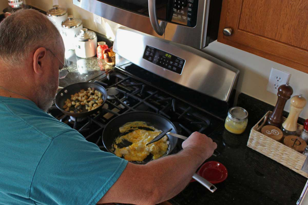 David scrambling eggs for the breakfast burritos.