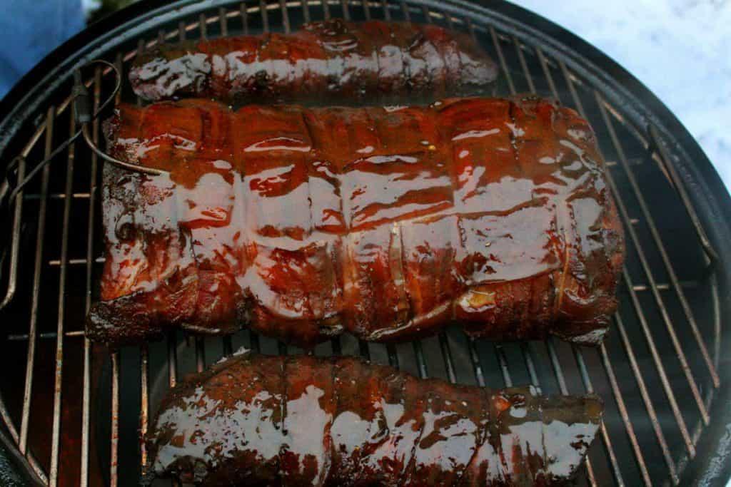sauced bacon wrapped pork loin on the smoker