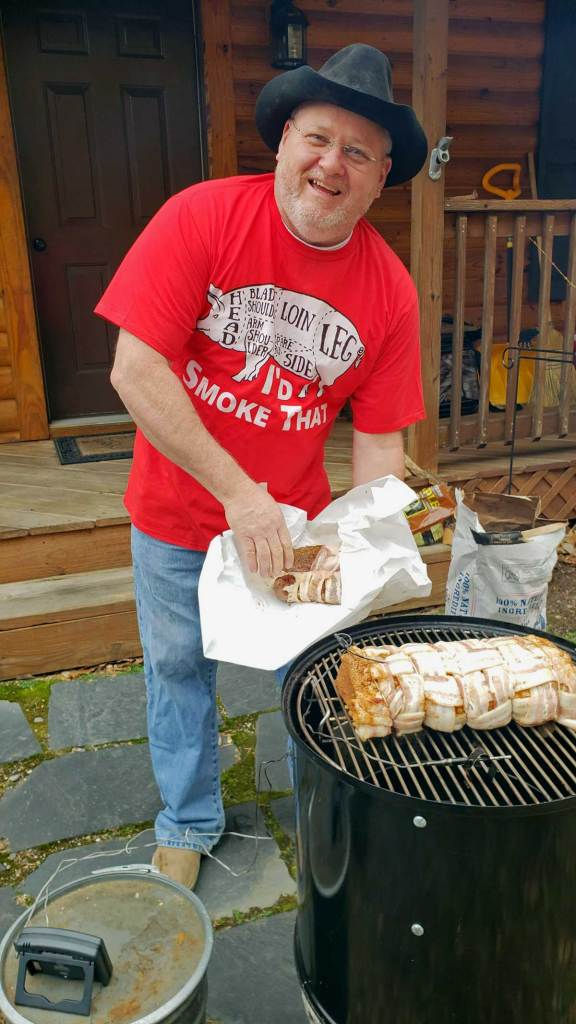 david putting the meat on the smoker