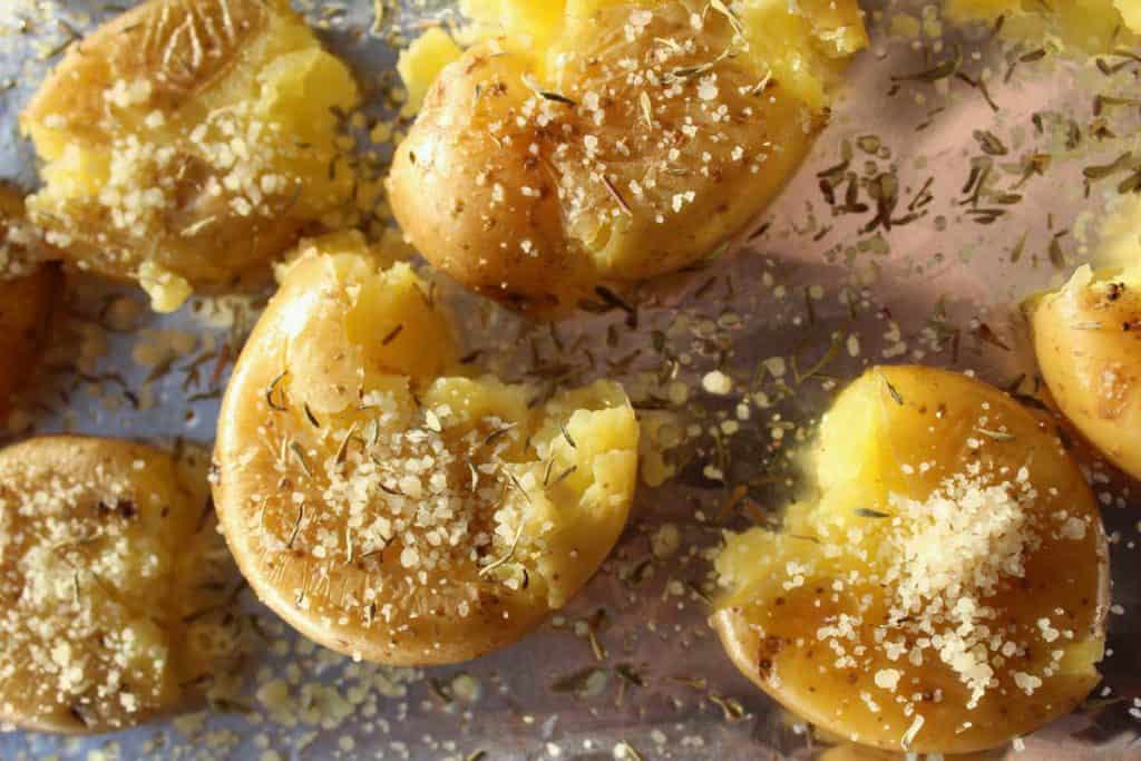Smashed potatoes sprinkled with parmesan and thyme.