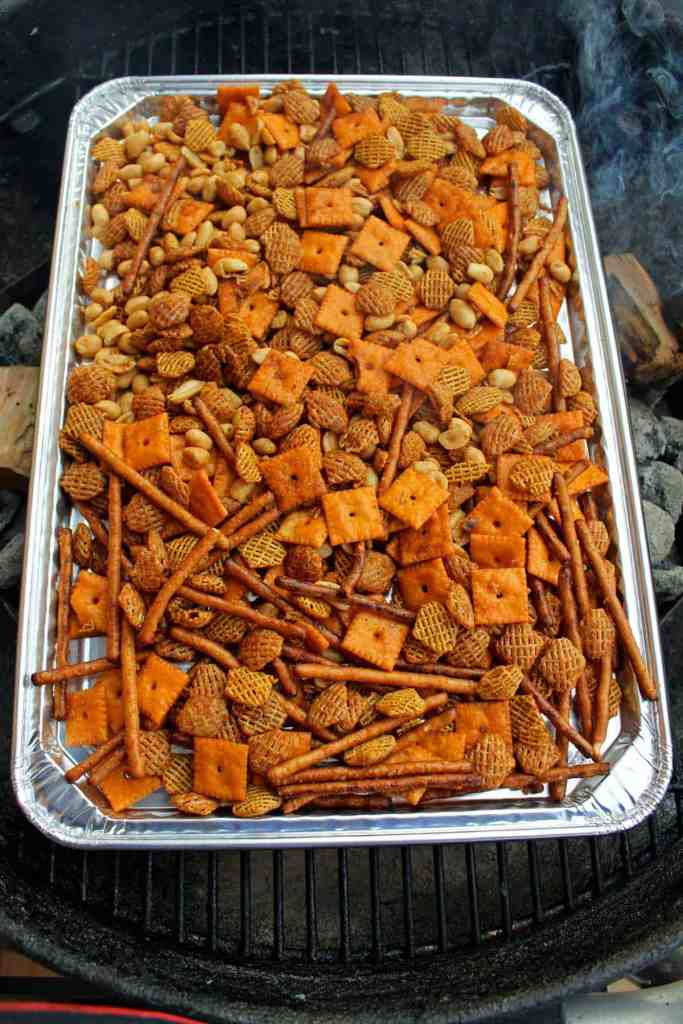 pan of snack mix on the grill
