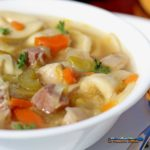 Tortellini in Brodo is made of soft pillowy cheese tortellinin in a rich flavorful broth of vegetables, smoked ham, parmesan cheese rind, and lemon zest.
