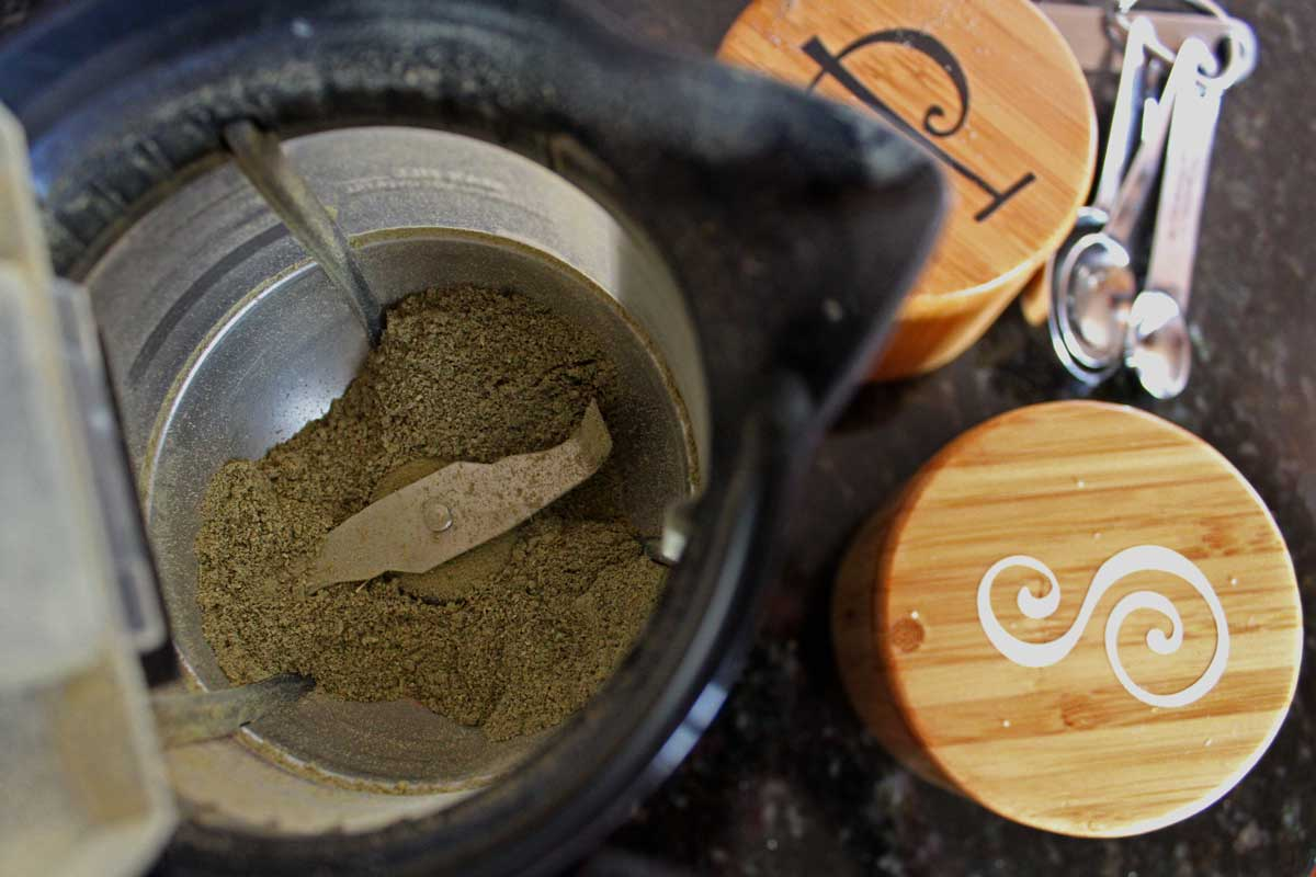 spice grinder with powdered spice inside