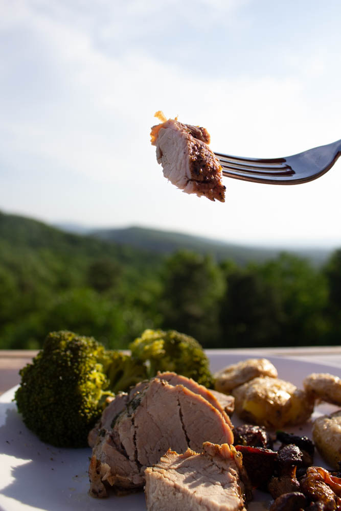 a bite of roasted pork tenderloin on a fork