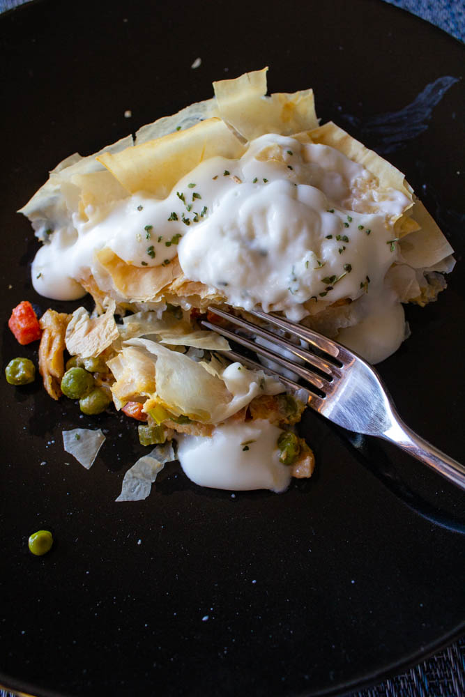 Healthy chicken pot pie loaded with juicy chicken and fresh vegetables, topped with a golden brown phyllo dough crust. Low-calorie, so enjoy guilt-free!