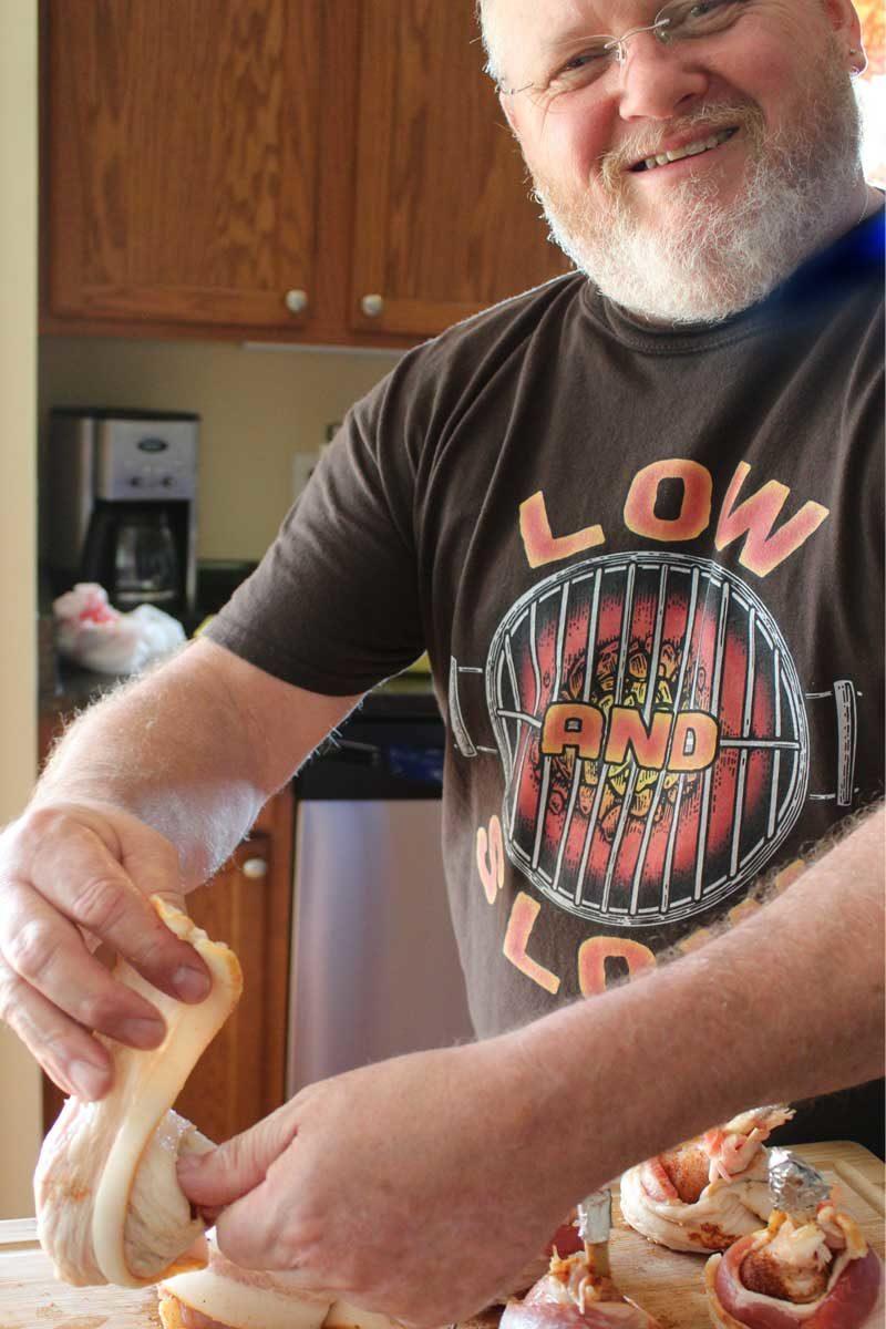 David prepping bbq chicken lollipops