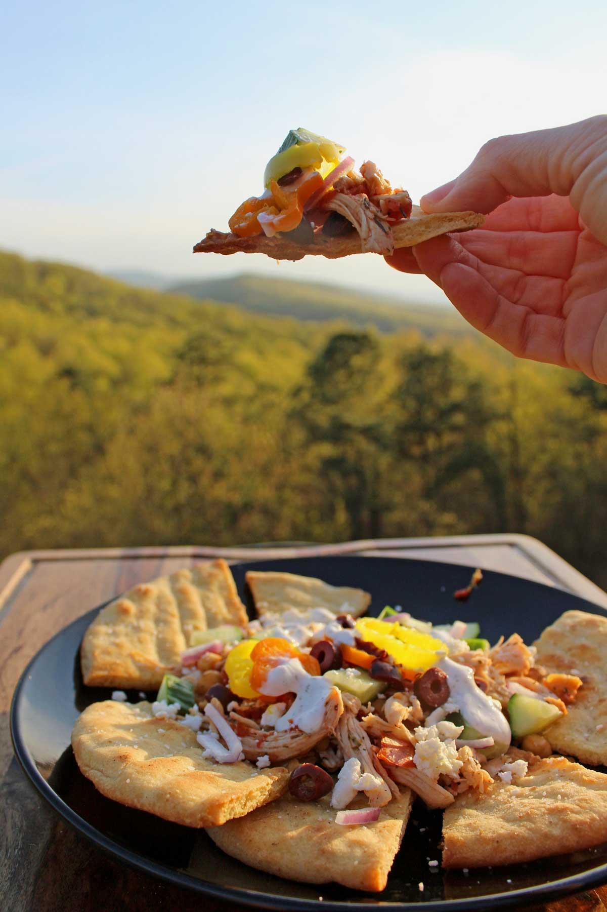 Greek nachos are a lighter healthier twist on traditional nachos. A fun flavor-packed culinary mashup combing two food favorites: nachos and Greek salad.