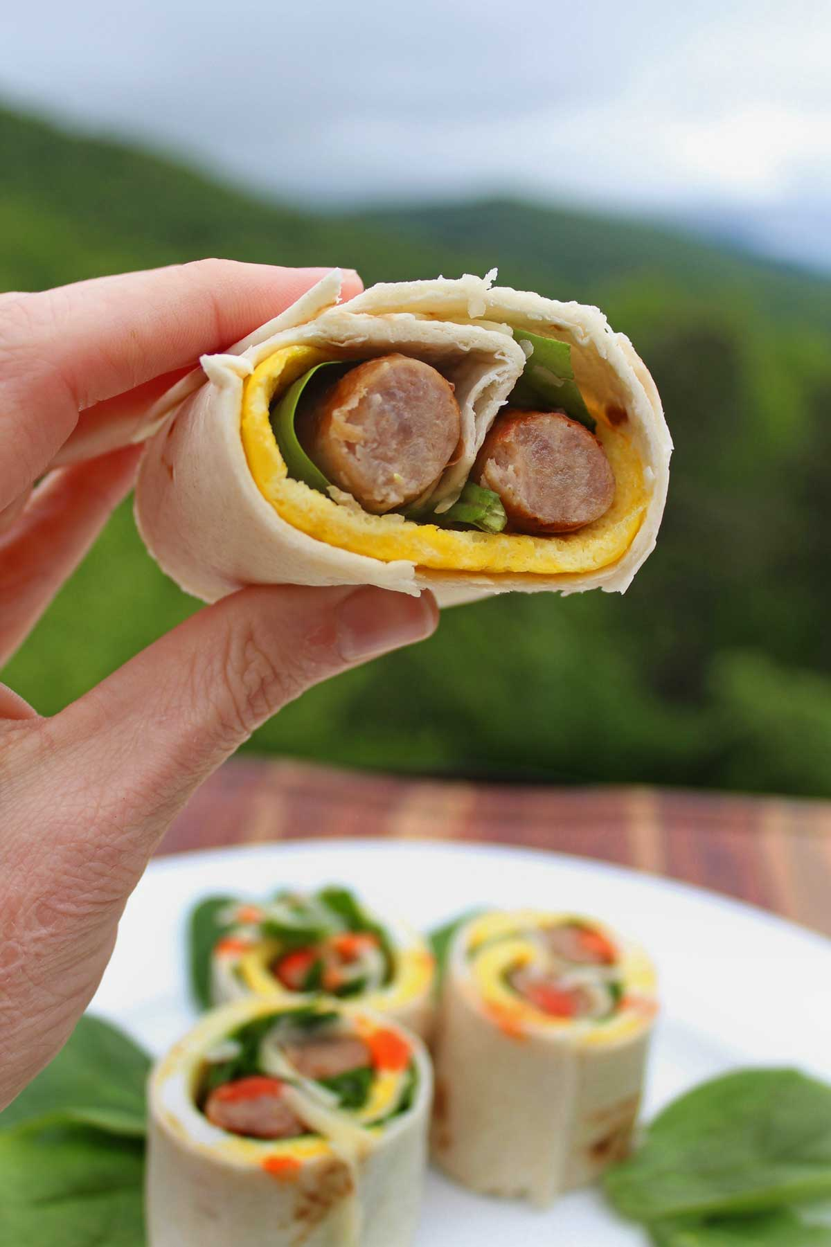 Need a quick breakfast on the run?. Breakfast roll-ups are filled with juicy breakfast sausage, eggs, cheese and spinach. Jumpstart your day with hot sauce!
