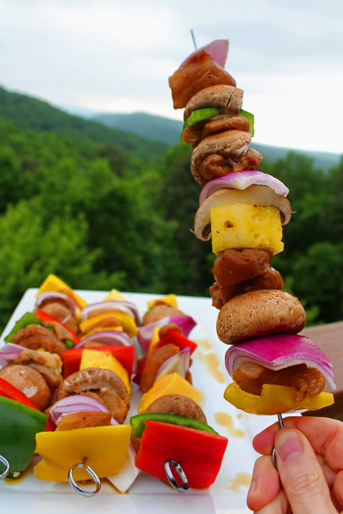 Grilled teriyaki chicken kabobs is a fun and flavorful recipe for the grill, made with tender juicy chicken, mushrooms, pineapple, peppers, and red onion.