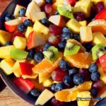 summer fruit salad mixed in bowl
