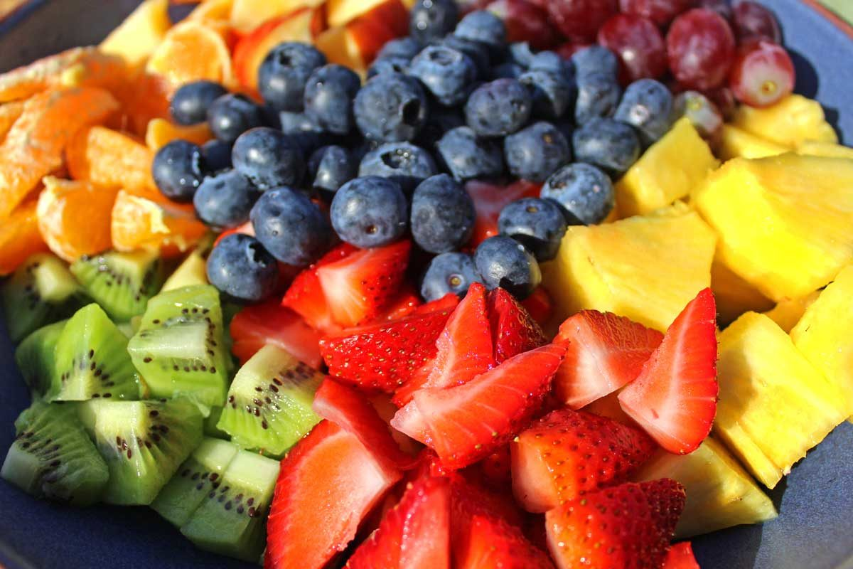 fruit and berries chopped inside a bowl