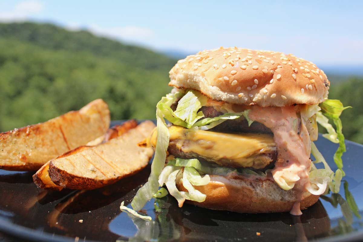 Big Twin Double Cheeseburger on plate with mountain view