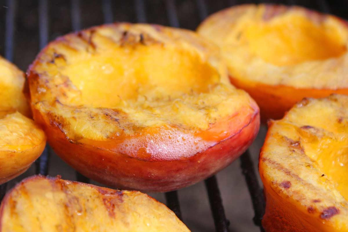 juicy grilled peach on grill