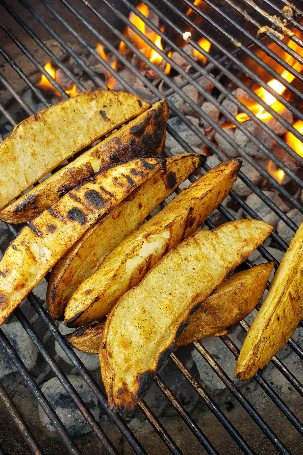 Grilled potato wedges hot and coming at ya straight from the grill! A smoky crisp outside, fluffy and creamy inside. Also try Barbecued Potato Wedges!!