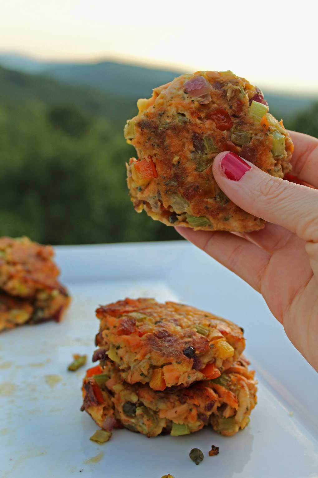 Similar to deviled crab, these deviled salmon cakes are made with fresh salmon, and a vegetable medley with capers, Worcestershire, Old Bay, and Dijon.
