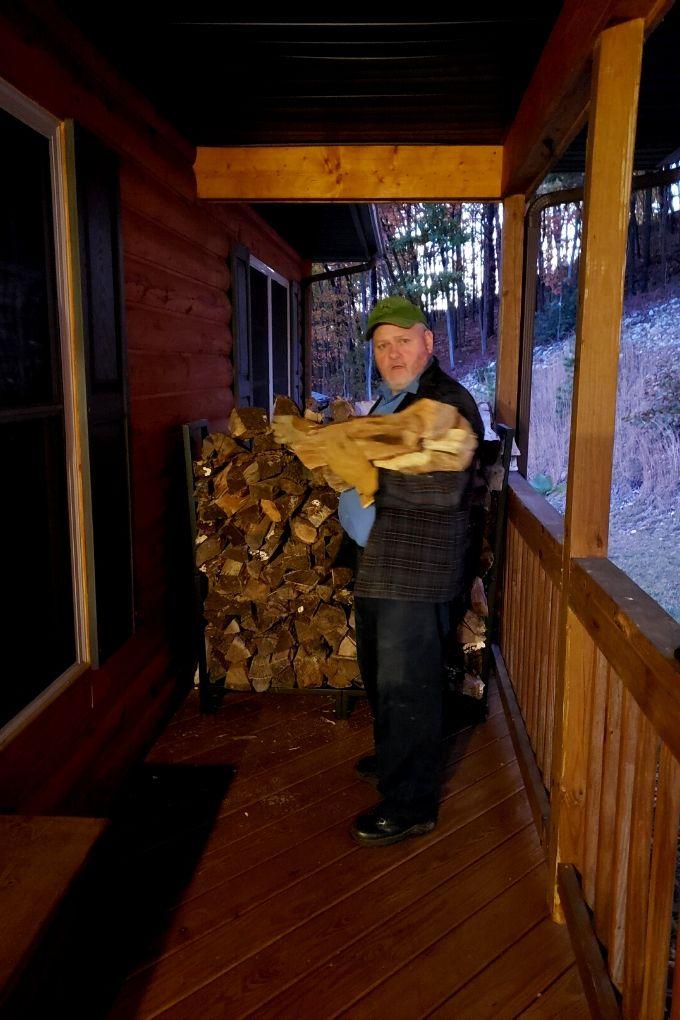 David putting firewood on porch