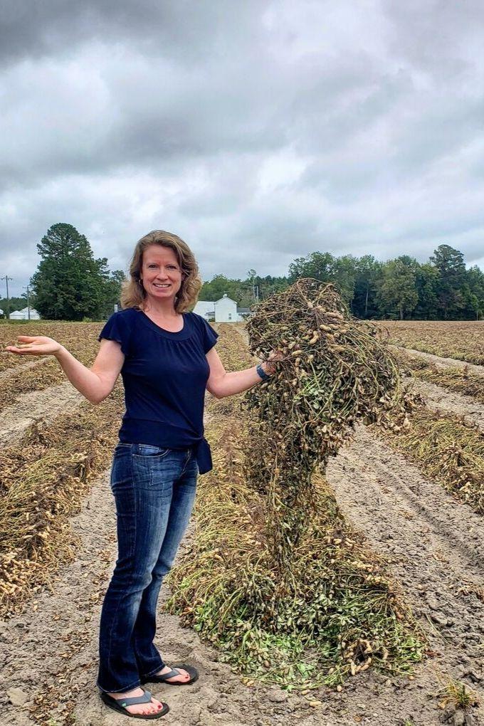 Debbie standing in the peanut field