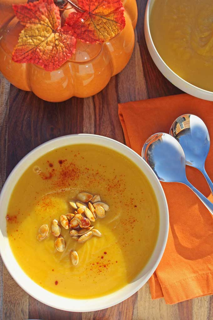 Pumpkin-apple soup made with homemade pumpkin puree that's velvety smooth and delicious! Healthy, gluten-free, dairy-free, vegan and ready in under an hour!
