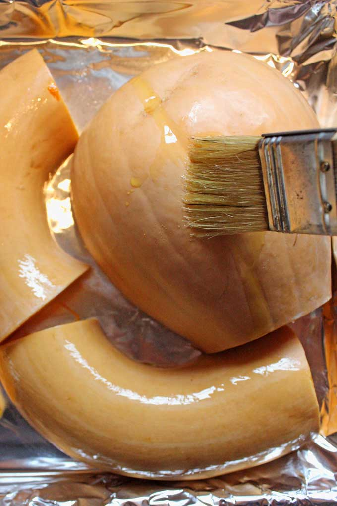 brushing neck pumpkin with oil