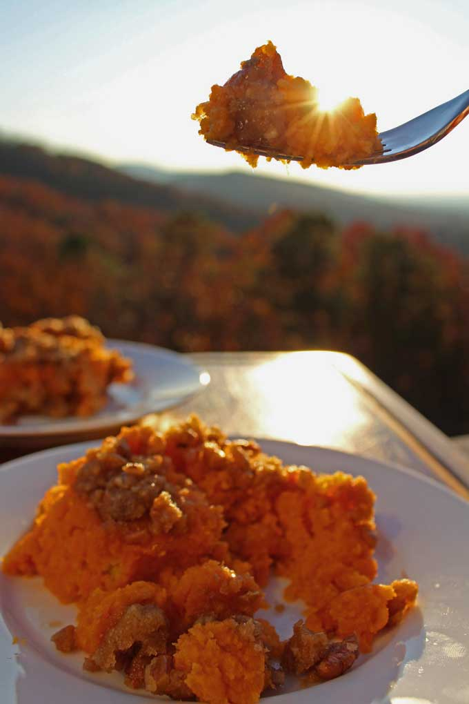 The sweet potatoes in this Sweet Potato Casserole bake up soft and fluffy and the crunchy topping makes it irresistible. Serve as a side dish or dessert!