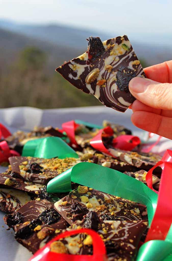This holiday chocolate bark is made with rich dark chocolate and creamy white chocolate embellished with tart dried cherries and slightly salty pistachios.
