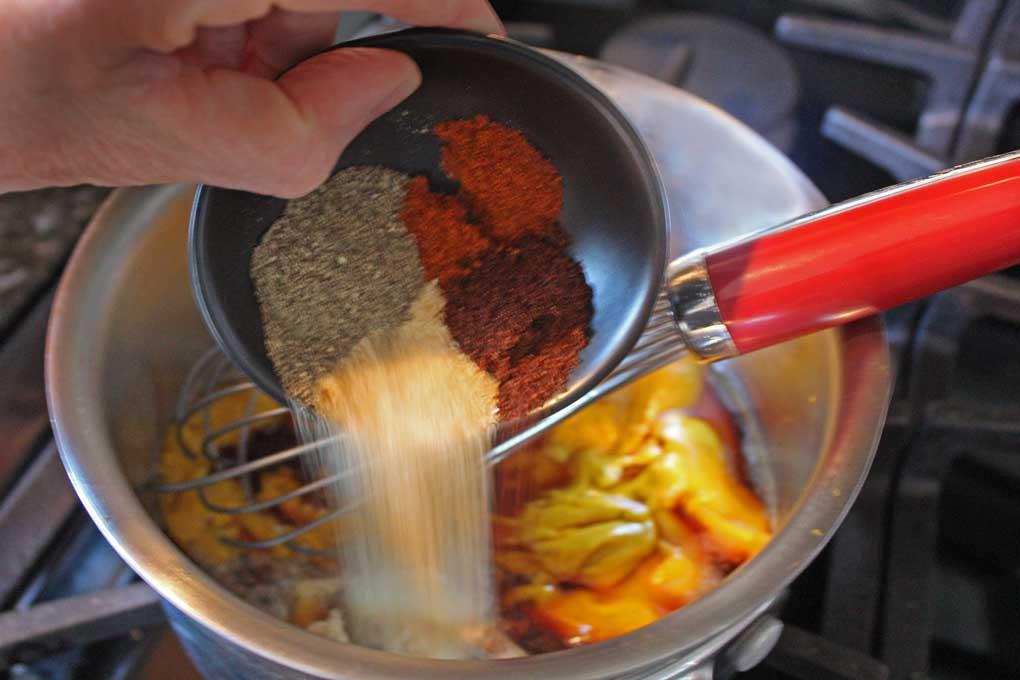 pouring spices into saucepan