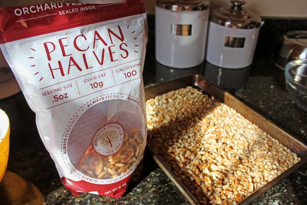Millican Pecan Halves chopped on sheet pan