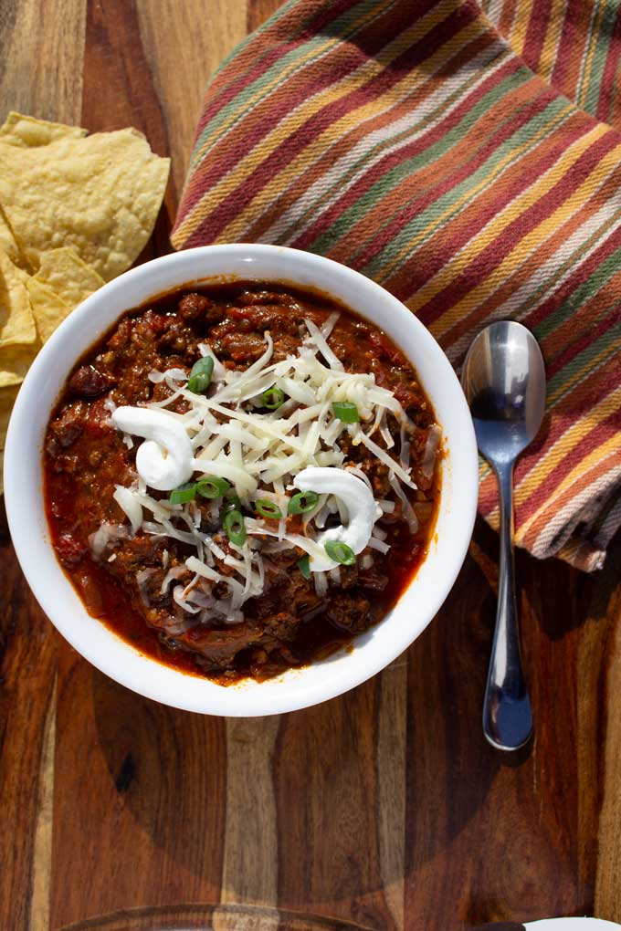 This smoked brisket chili is loaded with smoky beef, a medley of chiles, onion, and beans, smothered in a silky tomato chili sauce. A great crock-pot recipe!