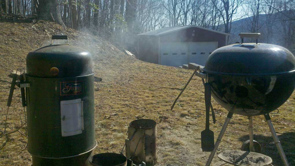 brinkman smoker and weber grill in yard