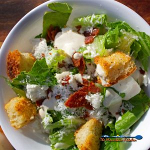 Caesar Salad With Pepperoni Bits and Feta