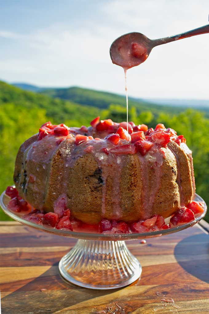 This made from scratch all-natural strawberry bundt cake packs a double-whammy of strawberry flavor and is the summer-time dessert you need in your life!