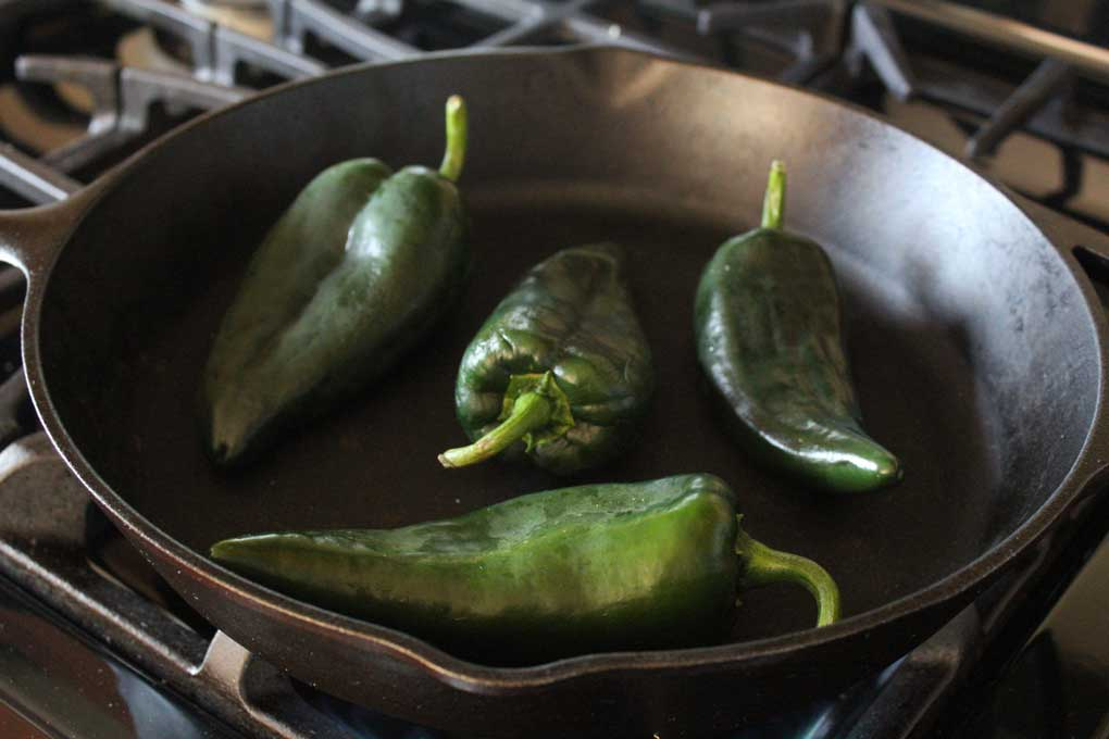 poblano peppers in pan