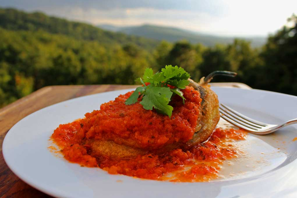 authentic chiles rellenos on plate with mountain view