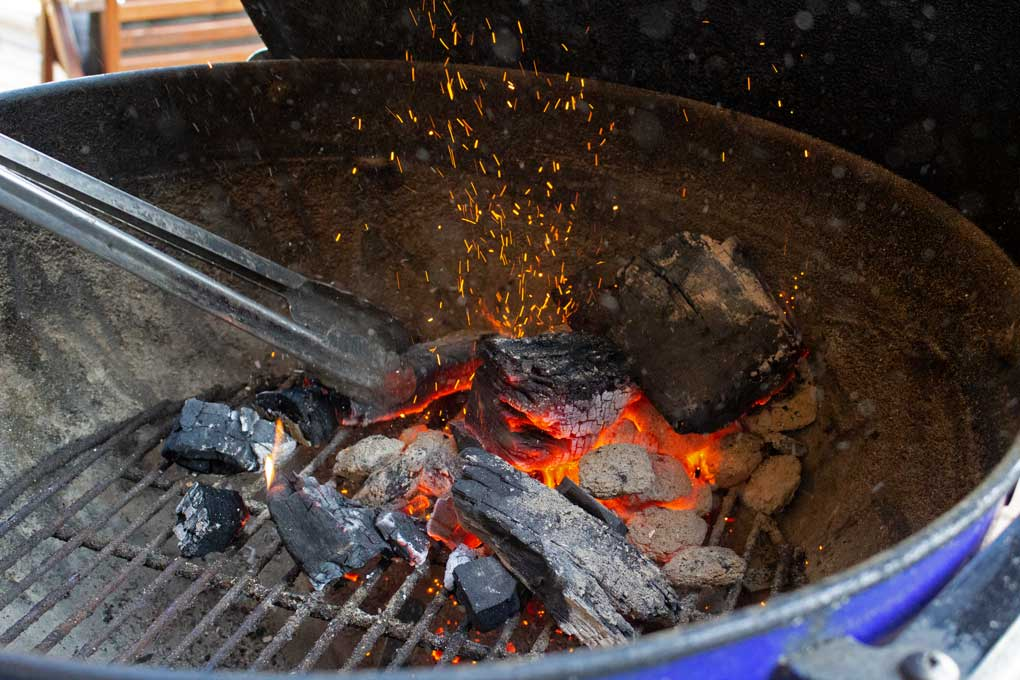 preparing hot coals for meat