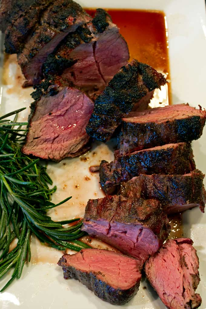 A step-by-step guide to smoked beef tenderloin with reverse sear that results in melt in your mouth, tender, juicy beef with a garlicky herb-seared crust.