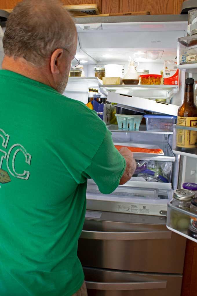 placing salmon fillet in refrigerator