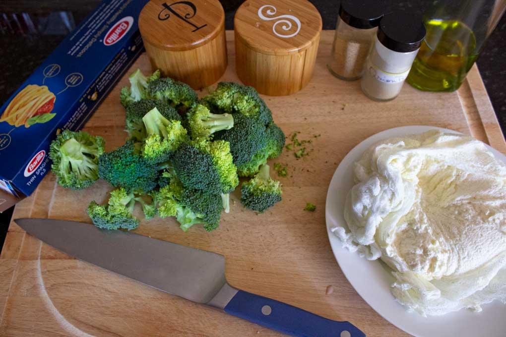 pasta, broccoli and ricotta on cutting board