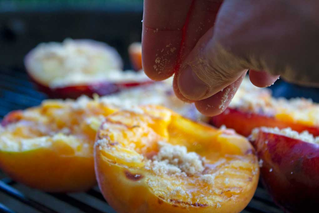 sprinkling peaches and plums with brown sugar